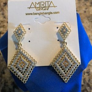 Gold tone and crystal earrings. Brand new!!